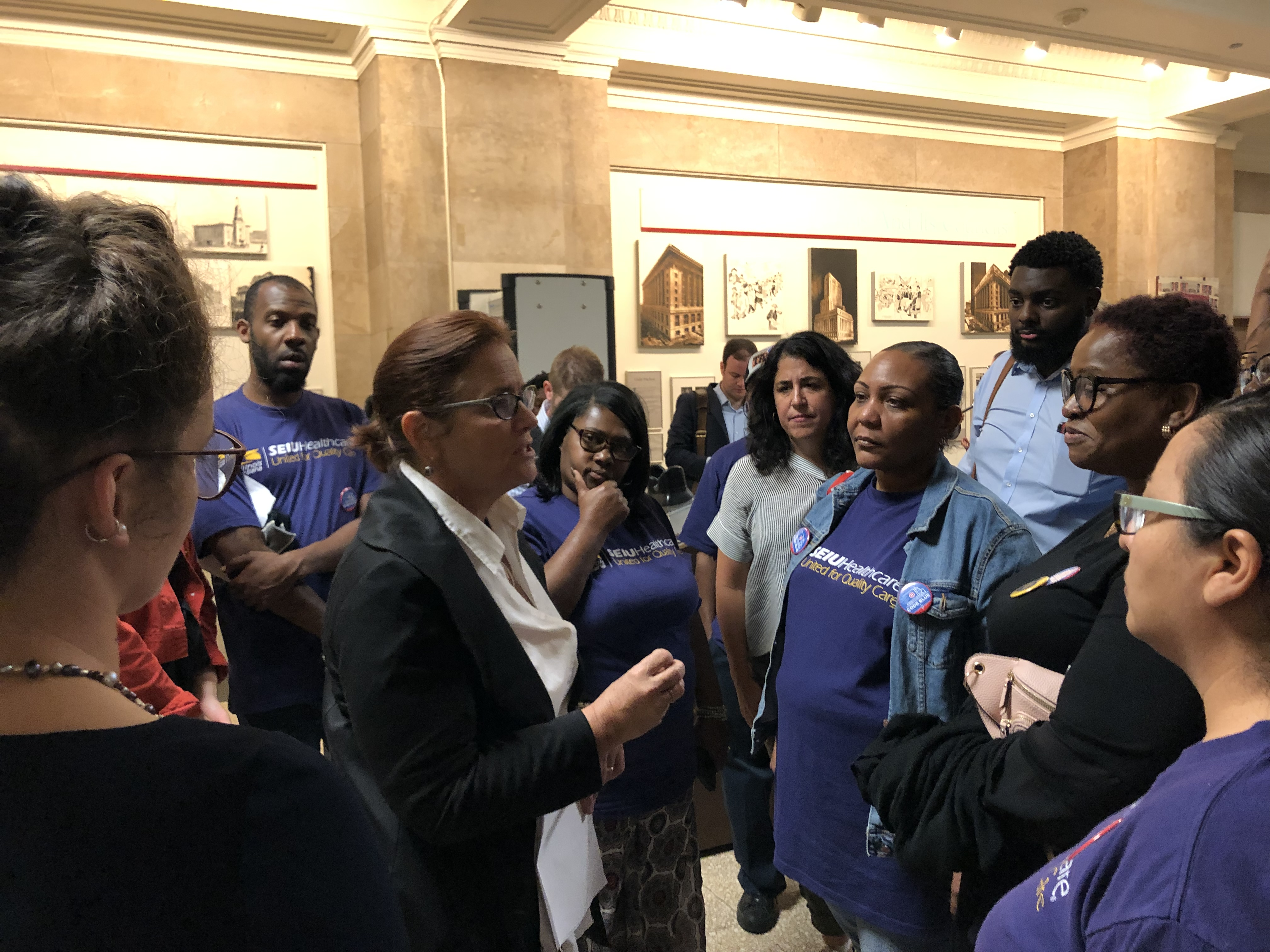 Committee Chairwoman Sue Sadlowski-Garza meets with workers